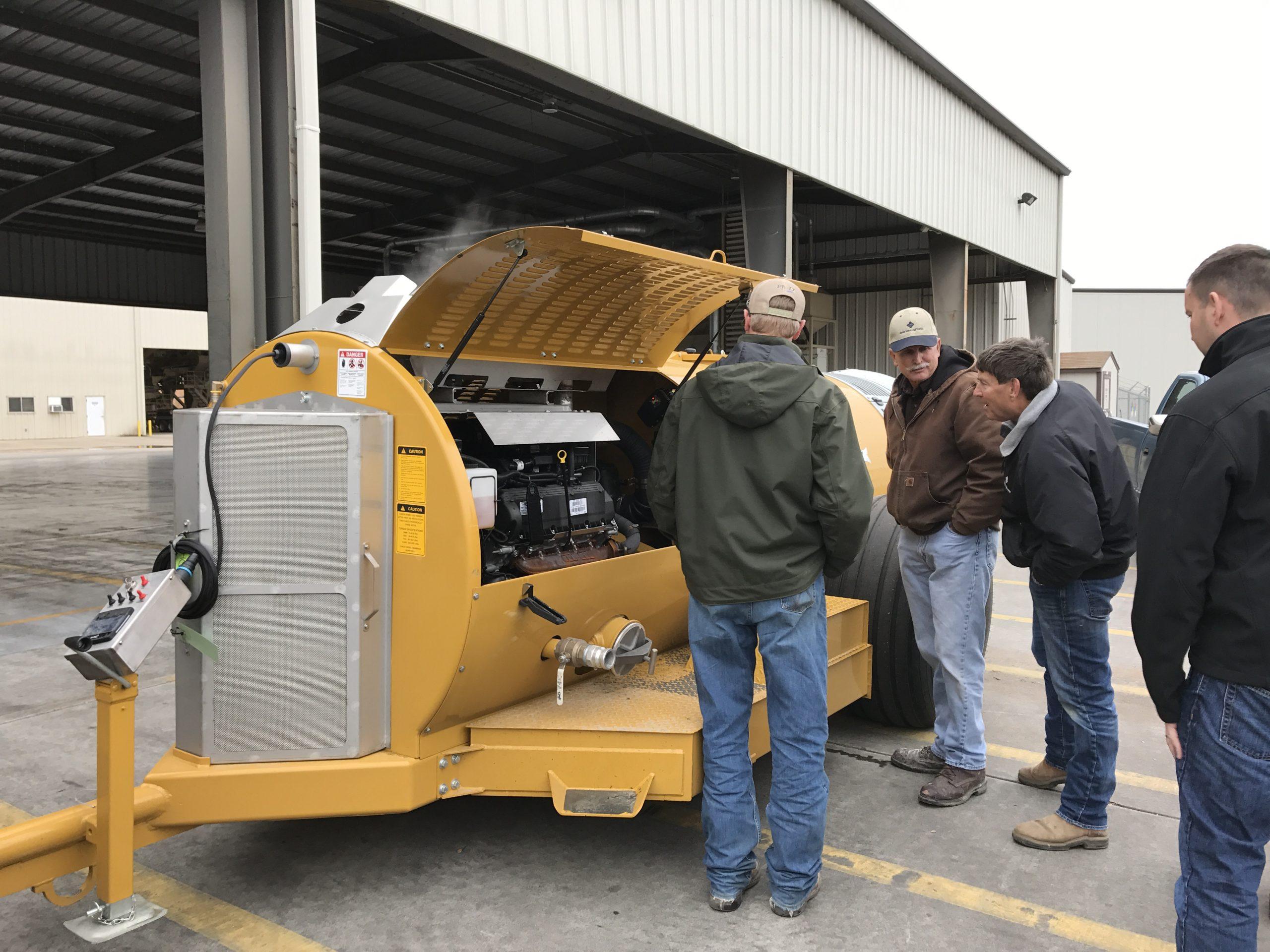 Partners Examining Equipment